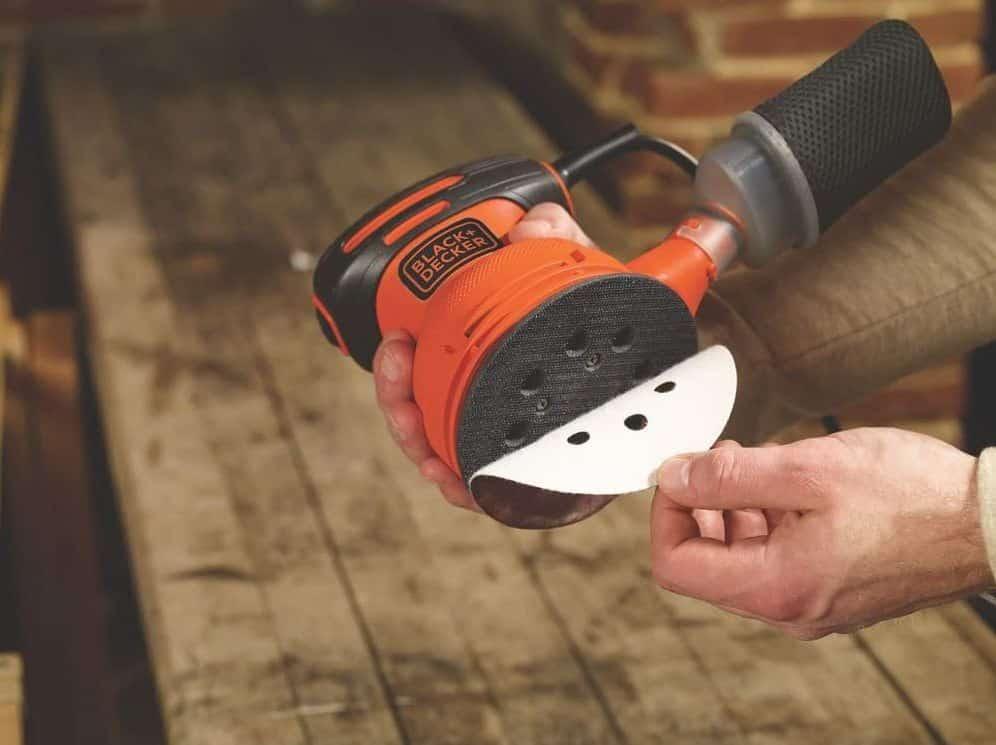 wood worker showing rotary sander bottom